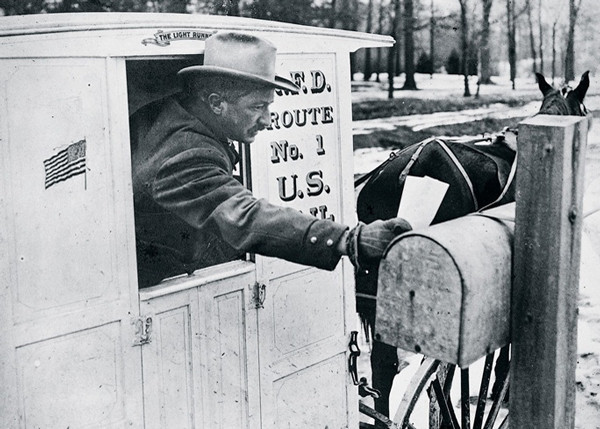 USPS mailman delivering mail – history of the United States Postal Service