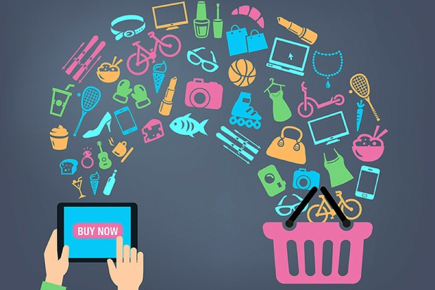 Person holding tablet and items transferring into online shopping cart – 2015 ecommerce trends and tips