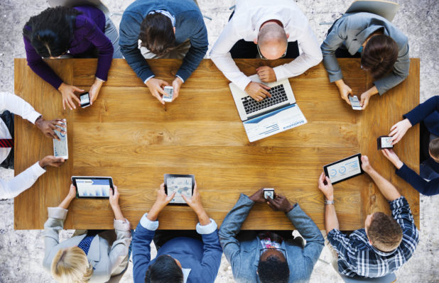 group of people viewing social media on varying devices